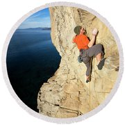 Climber Reaches For Hand Hold Round Beach Towel