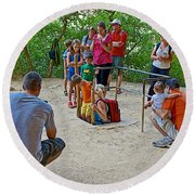 Climbing Down The Ladder Into A Kiva At Spruce Tree House In Mesa Verde National Park-colorado Round Beach Towel