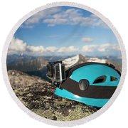 Climbing Helmet With Camera On Mountain Round Beach Towel