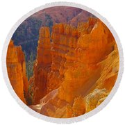 climbing out of the Canyon Round Beach Towel