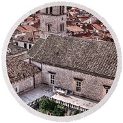 Cloistered Garden And Tower In The White City Round Beach Towel