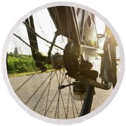 Close Up Of Wheel Of Bicycle On Road Round Beach Towel