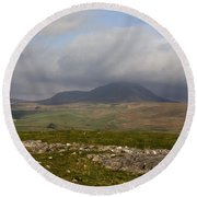 Cloud Streaming Across The Summit Of Pen-y-ghent Ribblesdale North Yorkshire England Round Beach Towel