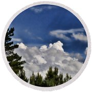 Clouds Like Mountains Behind The Pines Round Beach Towel