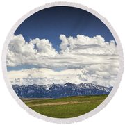 Clouds Over A Mountain Range In Montana Round Beach Towel
