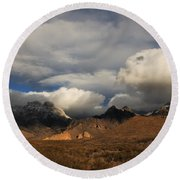 Clouds Over The Organ Mountains Round Beach Towel