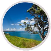 Coastal Farmland Landscape With Pohutukawa Tree Round Beach Towel