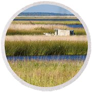 Coastal Marshlands With Old Fishing Boat Round Beach Towel by Bill Swindaman