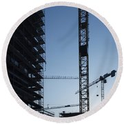 Construction Cranes In Backlit Round Beach Towel