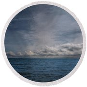 Contrails And Rainclouds Over Lake Michigan Round Beach Towel