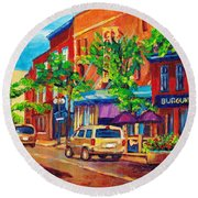 Corona Theatre Presents The Burgundy Lion Rue Notre Dame Montreal Street Scene By Carole Spandau Round Beach Towel