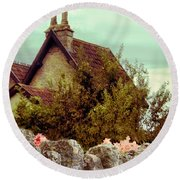 Cottage Seen Over A Wall Round Beach Towel