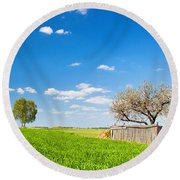 Countryside Landscape During Spring With Solitary Trees And Fence Round Beach Towel
