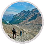 Couple Hiking On Plain Of Six Glaciers Trail  In Banff Np-albert Round Beach Towel