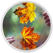 Couple Holding Autumn Leaves Round Beach Towel