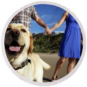 Couple Take Their Dogs For A Walk Round Beach Towel