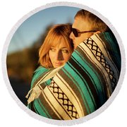 Couple Wraps Themselves In A Blue Round Beach Towel