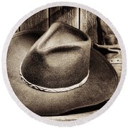 Cowboy Hat On Floor Round Beach Towel by Olivier Le Queinec