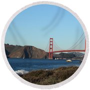 Crashing Waves And The Golden Gate Bridge Round Beach Towel by Linda Woods