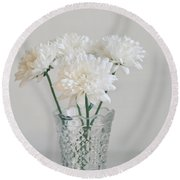 Creamy White Flowers In Tall Vase Round Beach Towel by Lyn Randle