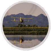 Crop Duster Applying Seed To Rice Field Round Beach Towel