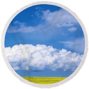 Cumulus Clouds Building Over Canola Round Beach Towel