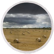 Dark Storm Clouds Over A Field With Hay Round Beach Towel