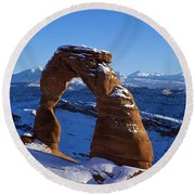 Delicate Arch In Snow Arches National Park Utah Round Beach Towel