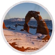 Delicate Arch With Snow At Sunset Arches National Park Utah Round Beach Towel