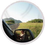 Detail Of Man In Side Mirror Of Car Round Beach Towel