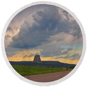 Devils Tower On The Horizon At Sunset Round Beach Towel