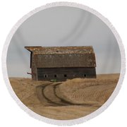 Dirt Road To An Old Leaning Barn Round Beach Towel