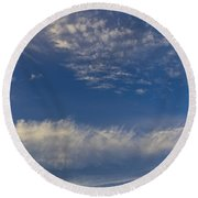 Distant Clouds Round Beach Towel
