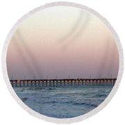 Distant Pier Sunset Round Beach Towel