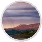 Distant Yukon Mountains Glowing In Sunset Light Round Beach Towel