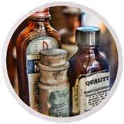 Doctor The Mercurochrome Bottle Round Beach Towel by Paul Ward