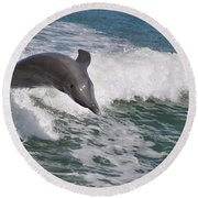 Dolphin Riding The Waves Round Beach Towel