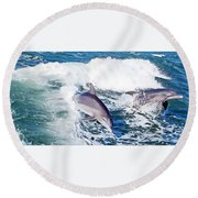 Dolphins Jumping Round Beach Towel