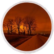 Down The Haunting Road Under The Orange Sky Round Beach Towel