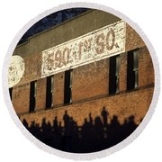 Downtown Seattle With Silhouetted Runners On Brick Wall Early Mo Round Beach Towel
