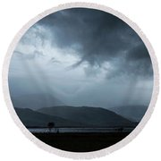 Dramatic Sky Over Silhouettes Round Beach Towel