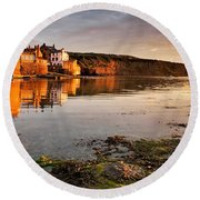 Early Morning Light On Robin Hoods Bay Round Beach Towel