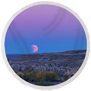 Eclipse Moonrise At Writing-on-stone Round Beach Towel