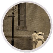 Edwardian Couple Walking On A Cobbled Street Round Beach Towel