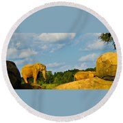 Elephants Among The Rocks. Round Beach Towel