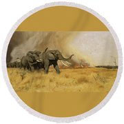 Elephants Moving Before A Fire Round Beach Towel