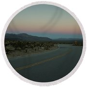 Empty Road In Desert At Sunset Round Beach Towel