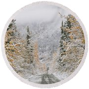 Empty Road Passing Through A Forest Round Beach Towel