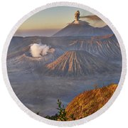 eruption at Gunung Bromo Round Beach Towel