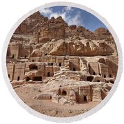 facade street in Nabataean ancient town Petra Round Beach Towel